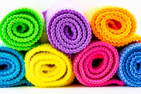 Background made of different colors of microfiber material, rolled up and stacked on top of each other, front view, macro shot. 写真素材