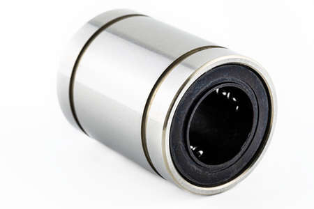 Macro shot of a linear bearing, isolated on a white background.