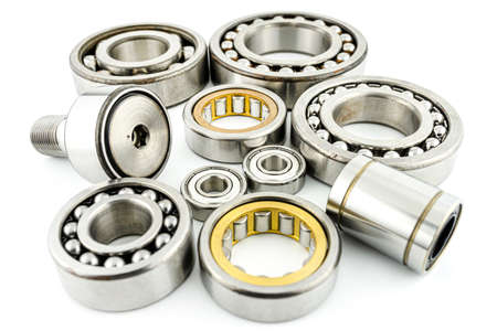 Background made of several ball bearings, isolated on a white background, selective focus.