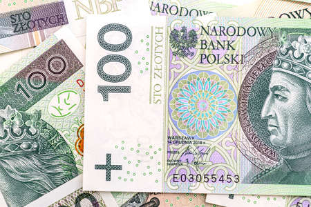 Macro photo of the front side of a Polish 100 PLN banknote, close-up on the inscriptions.