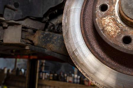 Grinded edge of the old rear brake disc in the car, regeneration of the brake system.