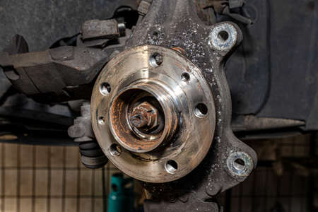 New front hub mounted in a car on a steering knuckle without a brake disc.