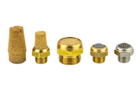 Macro shots of several air silencers lined up covered with brass balls and a metal mesh, isolated on a white background.