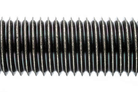 A background made of a macro shot of a black HF bolt thread with a hardness of 4.8, isolated on a white background.