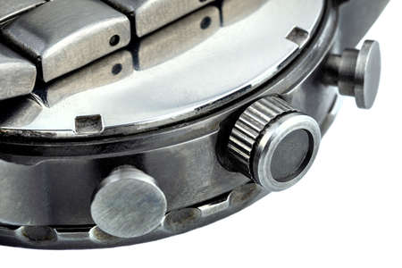 A macro shot of a dark metal stainless steel watch case and watchband, isolated on a white background. Standard-Bild