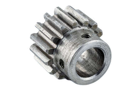 Macro shot of a steel gear with fifteen teeth, visible screw holes, isolated on white background.