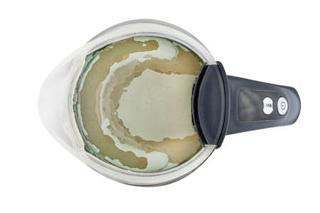 Limescale at the bottom of the kettle due to hard water, isolated on a white background with clipping path.