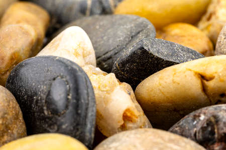 A macro shot of decorative colored pebbles, for use on a background.