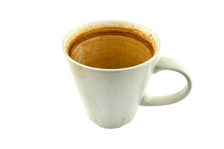 A soiled white ceramic mug with a coffee and tea residue inside, isolated on a white background