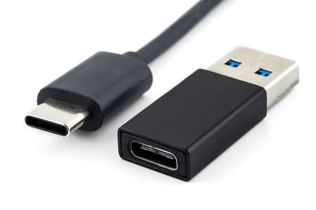 Macro shots of the USB 3.1 Type-C cable and adapter to USB 3.0 type A, isolated on a white background. Standard-Bild