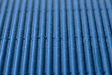 Background made of blue corrugated cardboard with vertical stripes, shallow depth of field. Standard-Bild