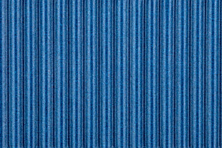Background made of blue corrugated cardboard with vertical stripes, view from above. Standard-Bild