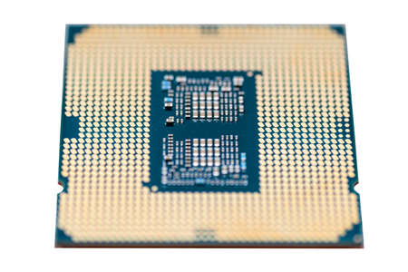 A macro photo of a modern CPU processor under the LGA 1200 socket on a green circuit board, isolated on a white background.