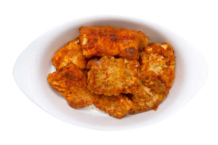 Fried cod fillets cut into squares lying on a white plate, isolated on a white background 版權商用圖片
