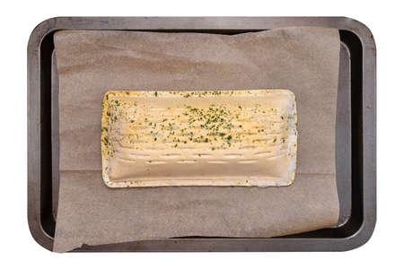 Frozen puff pastry with salmon lying on a baking sheet on baking paper, isolated on a white background, top view. 版權商用圖片