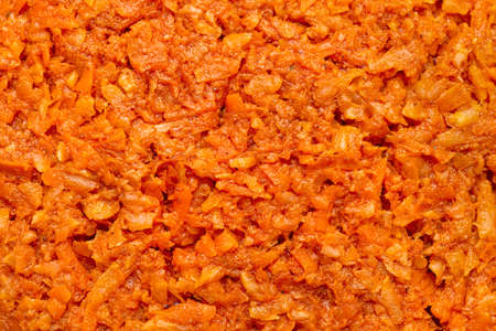 Background made from close up of a carrot salad, macro shot from the top view.