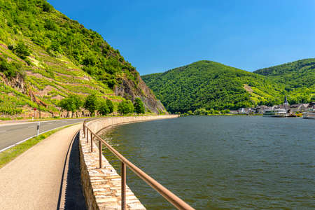 Beautiful view of the river flowing between the grape hills along the road in western Germany.