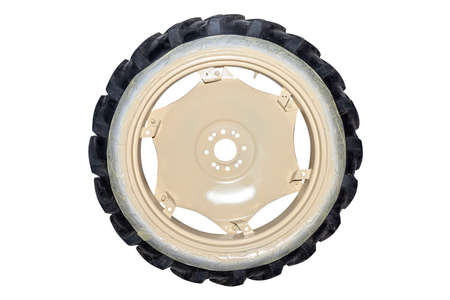 Freshly painted rims in a light color from a farm tractor, isolated on a white background with a clipping path. Stockfoto