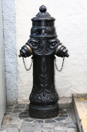 ancient hydrant, handmade ironwork Stock Photo