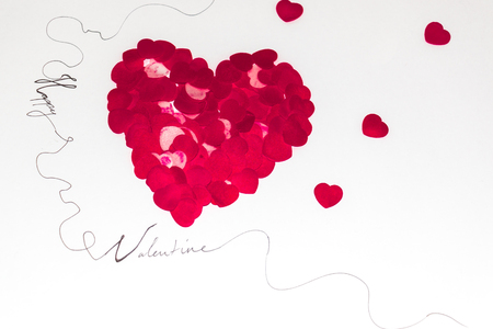 bigger red heart made of smaller red hearts on a white background