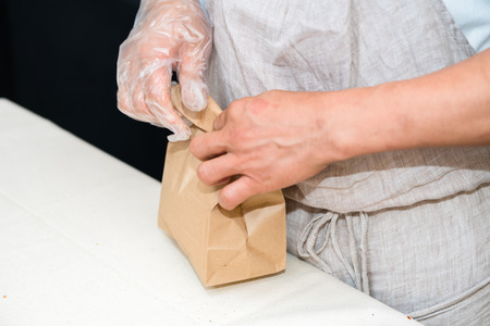 packing bread in to paper bag