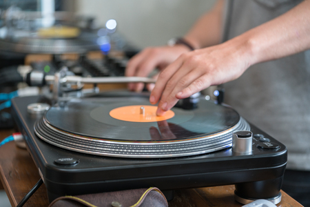 turn table: Dj play music at hip hop party.Turntable vinyl record player,analog sound technology for disc jockey to scratch vinyl records and mix tracks Stock Photo