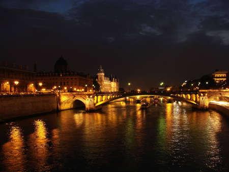 seine river at night with boat moving photo