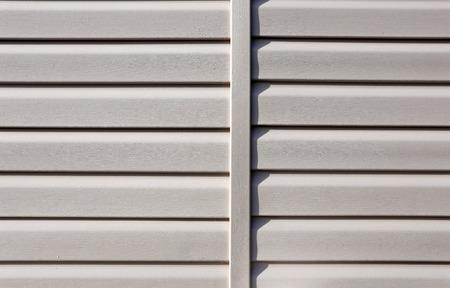 Installation on facade of the house panels beige vinyl siding Stok Fotoğraf