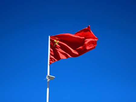 The national flag of the Soviet Union against the blue sky