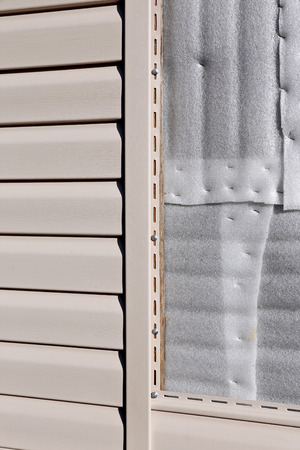 wall covering: Installation on facade of the house panels beige vinyl siding Stock Photo