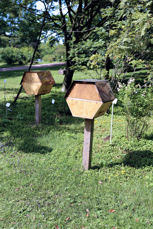 stamen wasp: Wooden beehive in a city park in Finland Stock Photo