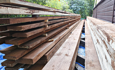 antiseptic: Many unplaned thick planks covered with antiseptic preparation