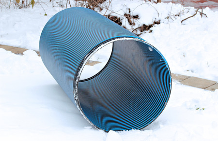 sump: Plastic pipe repair manhole ring on the snow