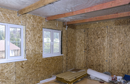 osb: Interior of frame house under construction made of OSB