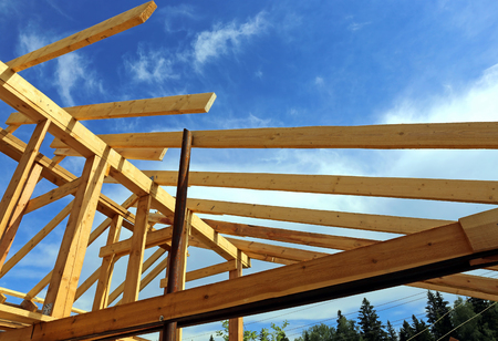 outbuilding: Installation of wooden beams at construction of the frame house