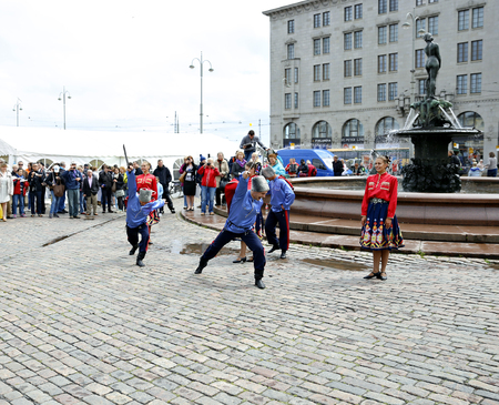 sabre: HELSINKI, FINLAND - JULY 10, 2015: Russian cossack Sabre Dance on the Market Square at the celebration of the Day of Russia in Helsinki