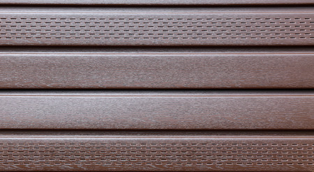 soffit cladding: Background of the brown plastic siding