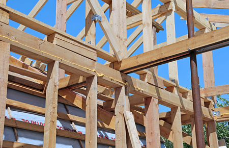 rafters: Installation of wooden beams at construction of the frame house