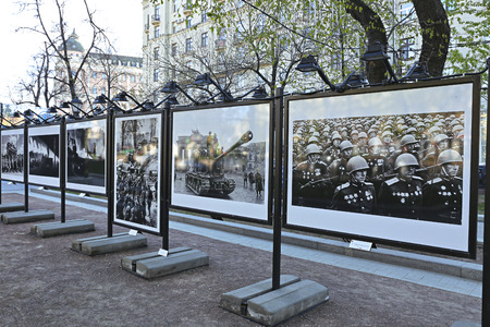 old photographs: MOSCOW, RUSSIA – MAY 7, 2015: Stands with old photographs of the military during World War II on the streets of Moscow in honor of the 70th anniversary of the victory
