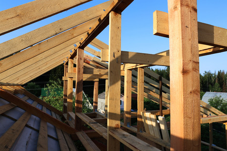 wooden joists: Installation of wooden beams at construction of the frame house