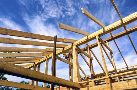 joists: Installation of wooden beams at construction of the frame house
