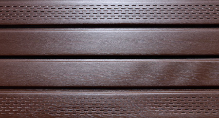 wall covering: Background of the brown plastic siding