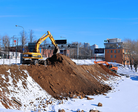 bulldozers: MOSCOW, RUSSIA - FEBRUARY 26, 2015: Bulldozers make the mound, doing ground works Editorial