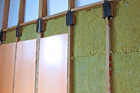 rock wool: Construction of walls of a frame house with different types of heat insulation Stock Photo