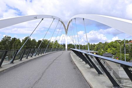 suomi: HELSINKI, FINLAND - JULY 11, 2015: Cable-stayed bridge across the street in Helsinki Editorial