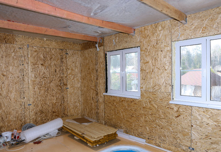 Interior of frame house under construction made of OSB