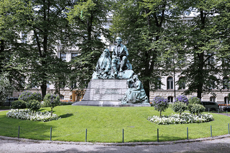 the publisher: HELSINKI, FINLAND - JULY 10, 2015: Monument Elias Lönnrot, the collector of folk poetry and publisher of Kalevala Editorial