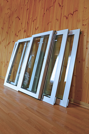 windows frame: Installation of plastic windows in the frame house