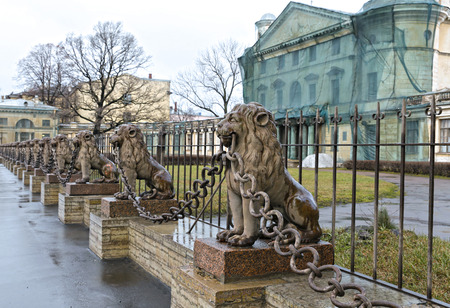 peterburg: SAINT PETERSBURG, RUSSIA - DECEMBER 2, 2015: Several statues of bronze lions along the fence in St. Petersburg