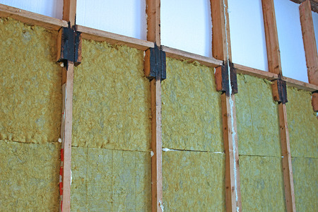 rockwool: Construction of walls of a frame house with different types of heat insulation Stock Photo